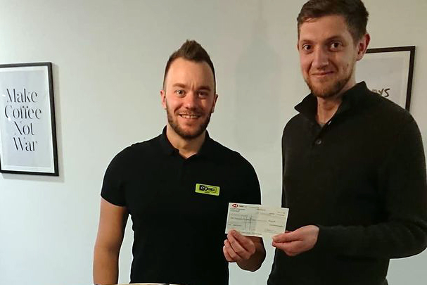 Lewis Morris hands cheque to Craig Field